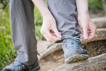 Hiker Tying Walking Shoes