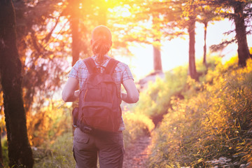 Woman Hiking in Forest at Sunset