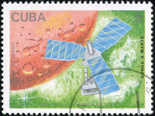 stamp printed in USSR  shown the sputnik on a green hum