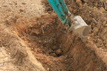 working excavator tractor in construction site