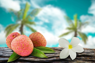 Lychee and flowers with  coconut and sky blur on background