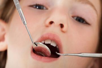 Girl Going Through Dental Examination