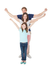 Happy Family With Arms Raised Standing In Line