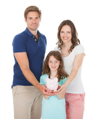 Happy Family Holding Piggy Bank Together