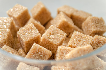 Brown sugar cubes in a glass