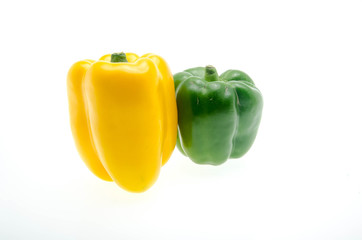 yellow and green bell peppers (capsicum) on a white background