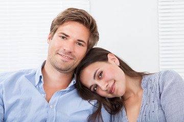 Woman Leaning Head On Man's Shoulder