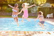 canvas print picture - Group Of Girls Jumping Into Outdoor Swimming Pool