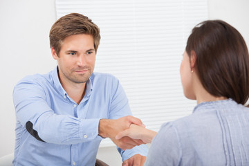 Smiling Candidate Shaking Hand With Businessman