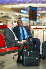 business travellers waiting for their flight