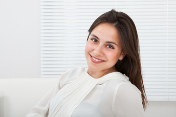 Confident Businesswoman Smiling In House