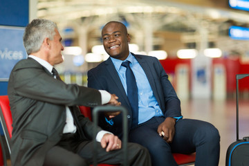 business travellers handshaking at airport