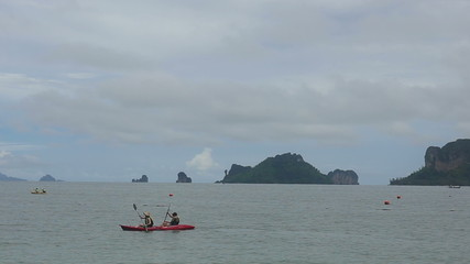 island with rocks in the azure sea near the beach