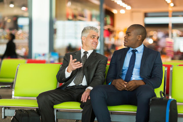 businessmen waiting for their flight at airport
