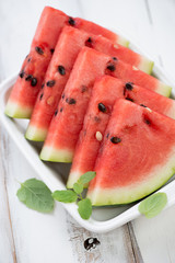 Close-up of watermelon slices with fresh mint, vertical shot