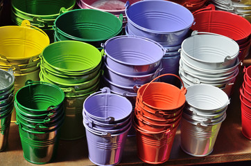 Collection of the varicolored metal buckets