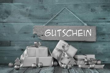 Weihnachtsgutschein in silber und mintgrün auf Holz
