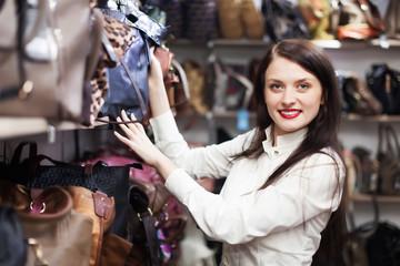Young woman choosing bag