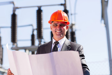 middle aged electrical manager with blueprint