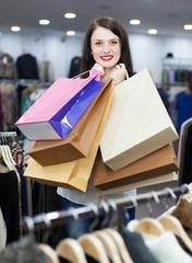 Joyful woman with shopping bags