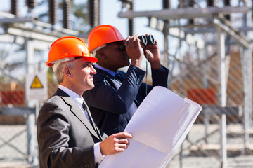 electrical managers with binoculars