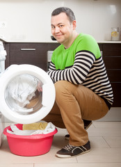 guy  doing laundry at home