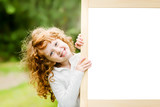 Fototapety Smiling girl near a white board. Educational and medical concept