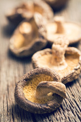 dried shiitake mushrooms on old wooden table