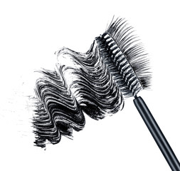 smear of black brush mascara and false eyelashes isolated on whi