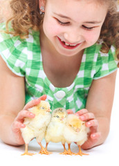 Happy little girl with chickens