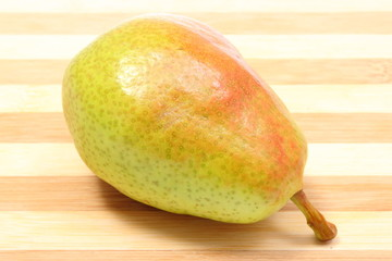 Fresh and natural pear on wooden cutting board