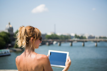 Tourist in Paris taking picture with digital tablet