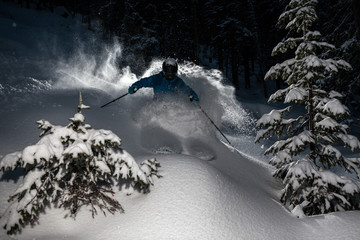 Skier go down powder snow