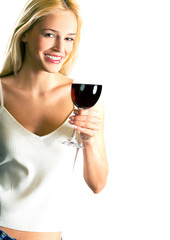 Young smiling blond woman with red-wine glass