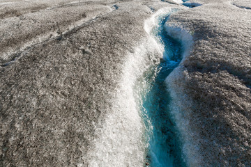 meltwater flowing from athabasca glacier