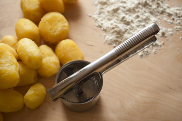 Boiled potatoes with masher