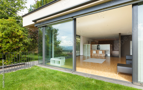 Leinwanddruck Bild outdoor of a modern house, garden