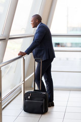 young african businessman with luggage at airport