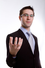 Portrait of young business man presenting and showing with copy