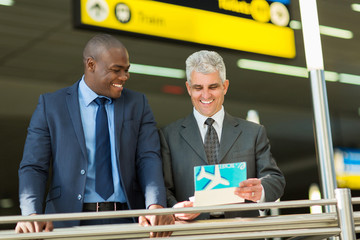 businessmen holding air ticket at airport