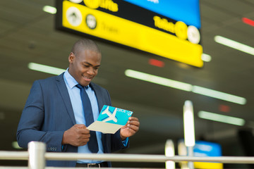 african american businessman checking his flight ticket