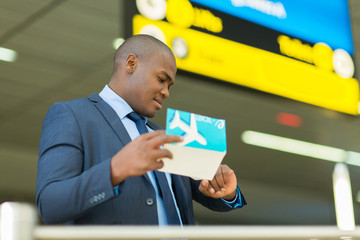 african american business traveller checking time