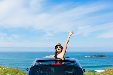 Woman on car vacation travel waving