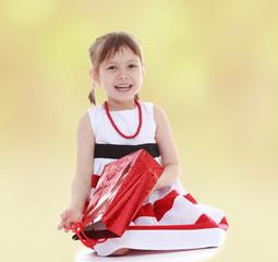 smiling girl sitting on the floor
