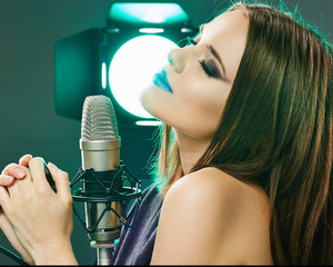 Woman microphone singing. Beauty model soun studio