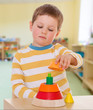 boy collects colored pyramid