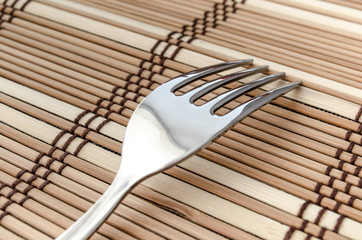 Silver fork on a napkin
