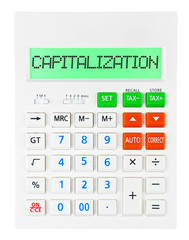 Calculator with CAPITALIZATION on display isolated on white