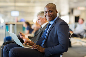 african business traveller with laptop computer