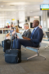 african businessman waiting for flight at airport